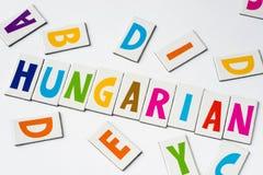 Η λέξη ουγγρικά έκανε των ζωηρόχρωμων επιστολών Στοκ Φωτογραφία