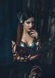 Η μάγισσα μαθαίνει μαγικό Στοκ Εικόνες