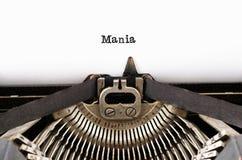 Η μανία ` λέξης ` από μια γραφομηχανή στο λευκό στοκ εικόνες με δικαίωμα ελεύθερης χρήσης