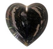 Η μαύρη καρδιά πάγου με τις φυσαλίδες και οι ρωγμές απομονώνουν Στοκ εικόνα με δικαίωμα ελεύθερης χρήσης