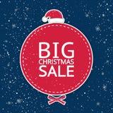 Η μεγάλη πώληση ` Χριστουγέννων επιγραφής ` στον κόκκινο κύκλο σε ένα μπλε υπόβαθρο Στοκ Εικόνες