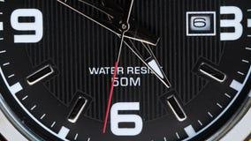 Η μετακίνηση των χεριών ενός wristwatch φιλμ μικρού μήκους