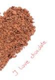 Η μισή από την καρδιά από την ξυμένη σοκολάτα στο άσπρο υπόβαθρο Στοκ εικόνες με δικαίωμα ελεύθερης χρήσης