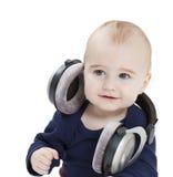 η μουσική ακούσματος αυτιών παιδιών τηλεφωνά στις νεολαίες Στοκ εικόνα με δικαίωμα ελεύθερης χρήσης