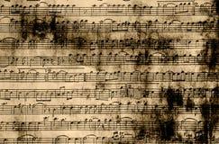 Η μουσική σημειώνει το εκλεκτής ποιότητας έγγραφο Στοκ Φωτογραφία