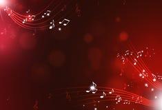 Η μουσική σημειώνει το κόκκινο υπόβαθρο Στοκ εικόνα με δικαίωμα ελεύθερης χρήσης