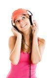 Η νέα γυναίκα ακούει μουσική Στοκ Εικόνες