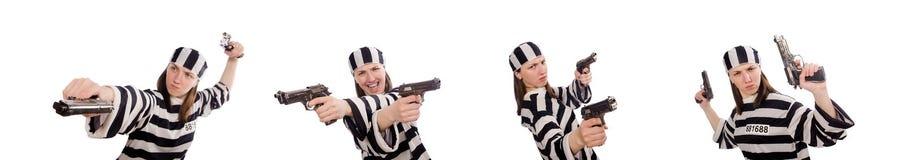 Η νέα γυναίκα στη φυλακή που απομονώνεται στο λευκό στοκ φωτογραφία