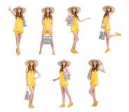 Η νέα γυναίκα στο κίτρινο θερινό φόρεμα που απομονώνεται στο λευκό Στοκ Εικόνες