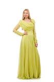 Η νέα γυναίκα στο κομψό μακρύ πράσινο φόρεμα που απομονώνεται στο λευκό στοκ εικόνες