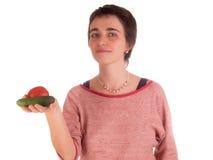 Η νέα ενήλικη γυναίκα με την κοντή τρίχα μια κόκκινη κορυφή, τζιν παντελόνι στο άσπρο υπόβαθρο σε διαφορετικό θέτει, και διάφορες Στοκ Εικόνες
