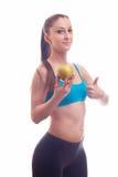 Η νέα κατάλληλη γυναίκα προσφέρει το μήλο Στοκ εικόνα με δικαίωμα ελεύθερης χρήσης