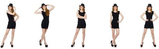 Η νέα κυρία στο μαύρο φόρεμα με το μαύρο καπέλο στοκ εικόνες με δικαίωμα ελεύθερης χρήσης