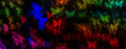 Η νύχτα ανάβει bokeh τη μορφή πεταλούδων, bokeh τα φω'τα, θαμπάδα Στοκ Εικόνες