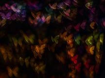 Η νύχτα ανάβει bokeh τη μορφή πεταλούδων, bokeh τα φω'τα, θαμπάδα Στοκ Εικόνα