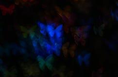 Η νύχτα ανάβει bokeh τη μορφή πεταλούδων, bokeh τα φω'τα, θαμπάδα Στοκ εικόνα με δικαίωμα ελεύθερης χρήσης