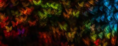 Η νύχτα ανάβει bokeh τη μορφή πεταλούδων, bokeh τα φω'τα, θαμπάδα Στοκ Φωτογραφίες
