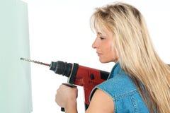 η ξανθή γυναίκα απασχολεί Στοκ Εικόνες