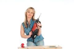 η ξανθή γυναίκα απασχολεί Στοκ Φωτογραφία