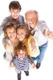 η οικογένεια που θέτει τ& στοκ εικόνες