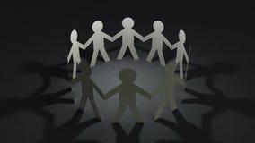 Η ομάδα των ανθρώπων κουκλών εγγράφου που κρατούν τα χέρια και κάνει τη γραμμή κύκλων απόθεμα βίντεο