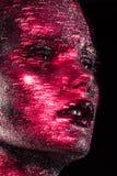 Η ομορφιά με το κόκκινο ακτινοβολεί Στοκ Εικόνες
