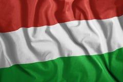Η ουγγρική σημαία κυματίζει στον αέρα Ζωηρόχρωμος, εθνική σημαία της Ουγγαρίας πατριωτισμός ελεύθερη απεικόνιση δικαιώματος