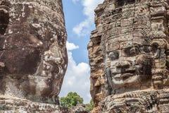Η πέτρα Bayon αντιμετωπίζει τον πύργο σε Angkor Wat, Siem συγκεντρώνει, Καμπότζη Στοκ Εικόνες