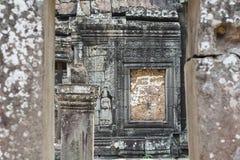 Η πέτρινη bas-ανακούφιση στο ναό Angkor, Siem συγκεντρώνει, Καμπότζη Ιστορική περιοχή της khmer αρχιτεκτονικής Στοκ Εικόνα