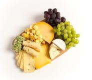 Η παραλλαγή πιάτων τυριών απομόνωσε το λευκό Στοκ Εικόνες
