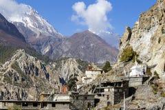 Η παραδοσιακή πέτρα χτίζει το χωριό Manang Βουνά στην ανασκόπηση Περιοχή Annapurna, Ιμαλάια, Νεπάλ Στοκ Φωτογραφία