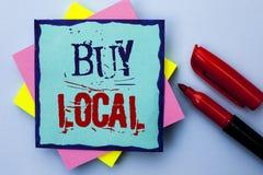 Η παρουσίαση σημειώσεων γραψίματος αγοράζει τοπικό Η αγορά αγοράς επίδειξης επιχειρησιακών φωτογραφιών ψωνίζει τοπικά λιανοπωλητέ στοκ εικόνες