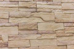Η περίληψη υποβάθρου τούβλου η σύσταση του λεκιασμένου παλαιού ανοικτό καφέ στόκου και του χρωματισμένου κόκκινου κίτρινου τοίχου Στοκ Εικόνες