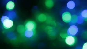 Η περιστροφή των Χριστουγέννων πολύχρωμη τα φω'τα απόθεμα βίντεο