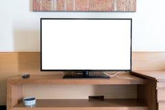Η πλαστή επάνω επίπεδη οθόνη TV με τη μακρινή επιτροπή επάνω το ράφι στο καθιστικό στο σπίτι στοκ εικόνες