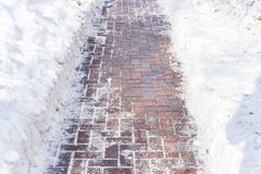 Η πορεία των πετρών επίστρωσης και του χιονιού Στοκ Φωτογραφίες