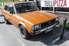 Η πορτοκαλιά καφετιά Toyota Corolla τέταρτης γενεάς Στοκ Εικόνες