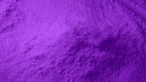 Η πορφυρή σκόνη χύνει στο σωρό φιλμ μικρού μήκους