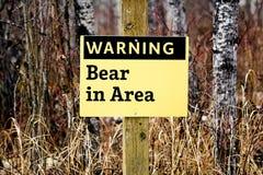 Η προειδοποίηση αντέχει στο σημάδι περιοχής Στοκ Εικόνα