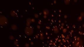 Η πυρκαγιά προκαλεί το υπόβαθρο E Πετώντας σπινθήρες πυρκαγιάς Θολωμένο φωτεινό φως r ελεύθερη απεικόνιση δικαιώματος