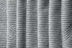 Η πλήρης σελίδα χαλαρού ενός γκρίζου πλέκει τη σύσταση υφάσματος Στοκ Φωτογραφία
