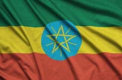 Η σημαία της Αιθιοπίας απεικονίζεται σε ένα ύφασμα αθλητικών υφασμάτων με πολλές πτυχές Έμβλημα αθλητικών ομάδων στοκ εικόνες με δικαίωμα ελεύθερης χρήσης