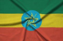 Η σημαία της Αιθιοπίας απεικονίζεται σε ένα ύφασμα αθλητικών υφασμάτων με πολλές πτυχές Έμβλημα αθλητικών ομάδων στοκ φωτογραφίες