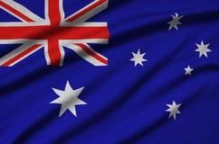 Η σημαία της Αυστραλίας απεικονίζεται σε ένα ύφασμα αθλητικών υφασμάτων με πολλές πτυχές Έμβλημα αθλητικών ομάδων στοκ φωτογραφία