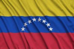 Η σημαία της Βενεζουέλας απεικονίζεται σε ένα ύφασμα αθλητικών υφασμάτων με πολλές πτυχές Έμβλημα αθλητικών ομάδων στοκ φωτογραφίες με δικαίωμα ελεύθερης χρήσης