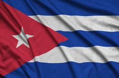Η σημαία της Κούβας απεικονίζεται σε ένα ύφασμα αθλητικών υφασμάτων με πολλές πτυχές Έμβλημα αθλητικών ομάδων στοκ φωτογραφίες με δικαίωμα ελεύθερης χρήσης