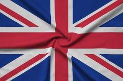 Η σημαία της Μεγάλης Βρετανίας απεικονίζεται σε ένα ύφασμα αθλητικών υφασμάτων με πολλές πτυχές Έμβλημα αθλητικών ομάδων στοκ εικόνες με δικαίωμα ελεύθερης χρήσης