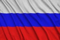 Η σημαία της Ρωσίας απεικονίζεται σε ένα ύφασμα αθλητικών υφασμάτων με πολλές πτυχές Έμβλημα αθλητικών ομάδων στοκ εικόνες με δικαίωμα ελεύθερης χρήσης