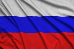 Η σημαία της Ρωσίας απεικονίζεται σε ένα ύφασμα αθλητικών υφασμάτων με πολλές πτυχές Έμβλημα αθλητικών ομάδων στοκ εικόνες