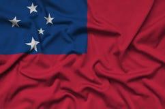 Η σημαία της Σαμόα απεικονίζεται σε ένα ύφασμα αθλητικών υφασμάτων με πολλές πτυχές Έμβλημα αθλητικών ομάδων στοκ εικόνα με δικαίωμα ελεύθερης χρήσης